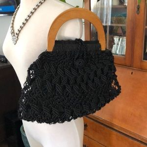 Handbags - Black wicker handbag with wood handles.